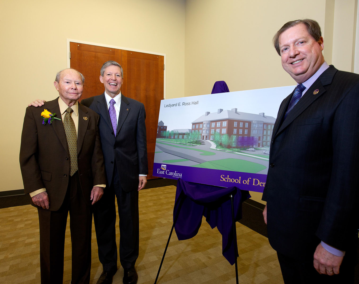 Left to right: Dr. Ledyard E. Ross, Greenville orthodontist; East Carolina University Chancellor Dr. Steve Ballard; and ECU School of Dentistry Dean Dr. James R. Hupp stand with a drawing of the School of Dentistry building, which will be named for Ross following a $4 million gift to the school. Photo by Cliff Hollis, ECU News Services.