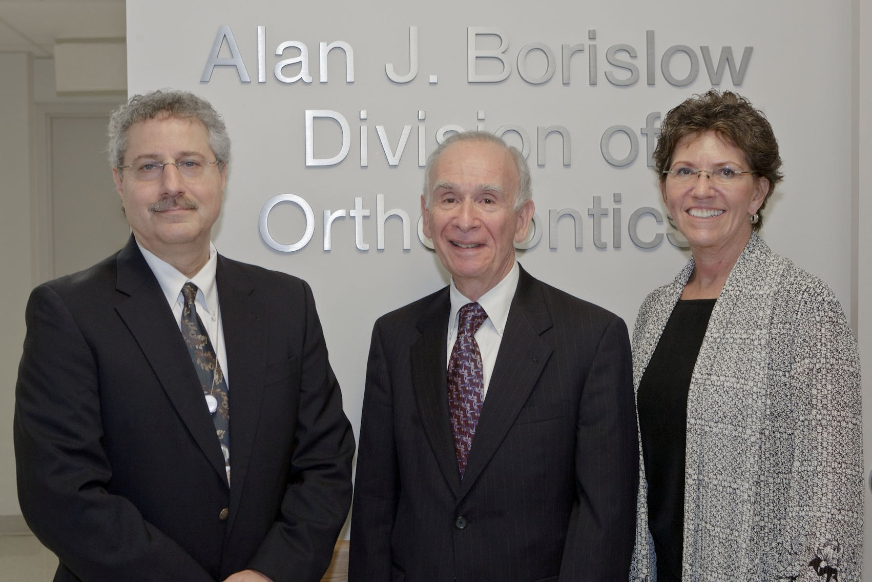 Pictured at the dedication reception are: (l. to r.) Dr. Frederic Barnett, Interim Chairman of Einstein's Maxwell S. Fogel Department of Dental Medicine; Dr. Alan J. Borislow, honoree; and Susan Bernini, Chief Operating Officer, Einstein Healthcare Network