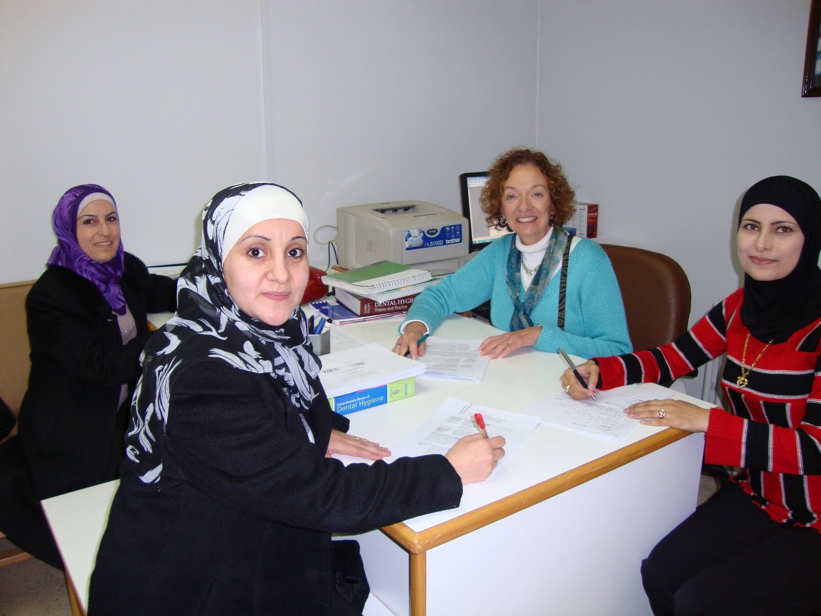 Professor Michele L. Darby (back right) teaching interested dental hygiene students at the Jordan Universty of Science and Technology. (Photo credit: Prof. Michele Darby)