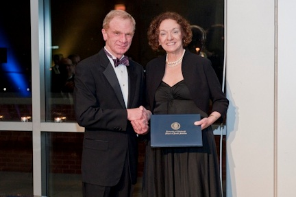 Dean Thomas W. Braun, University of Pittsburgh School of Dental Medicine, left, presents the 2011 Distinguished Alumni Award in Dental Hygiene to Professor Michele Darby, right.