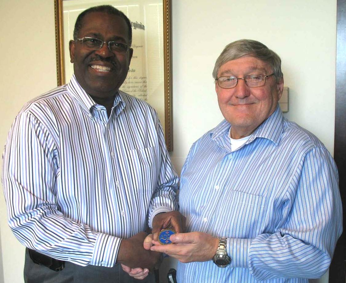 ADEA President Leo E. Rouse presents Dr. L. Jackson Brown, Editor of the Journal of Dental Education, with an ADEA Challenge Coin.