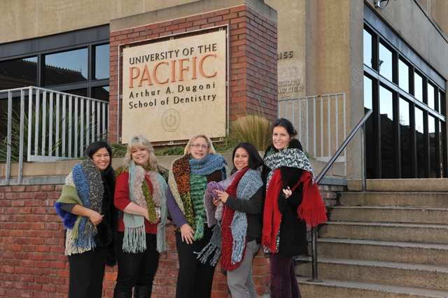 Staff and students at the University of the Pacific Arthur A. Dugoni School of Dentistry show off their knitting skills. (Photo courtesy University of the Pacific)