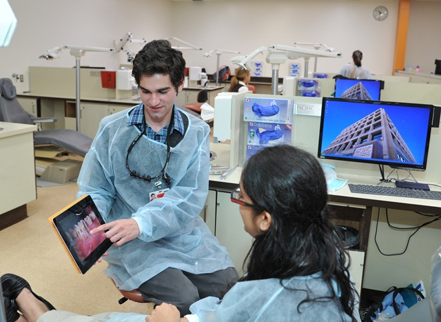 Students from the University of the Pacific Arthur A. Dugoni School of Dentistry use new iPads to enhance their dental education. (Photo courtesy University of the Pacific)