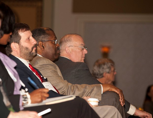 Members of the audience listen intently to the Point-Counterpoint panel discussion.